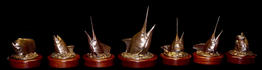 bronze head mount trophies on rotating mahogany bases